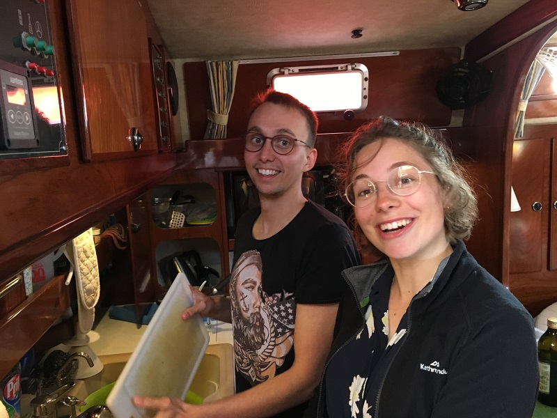 The good crew Mikkel and Lise do the dishes in Rhumb runners galley afte we have eaten their lovely dish.